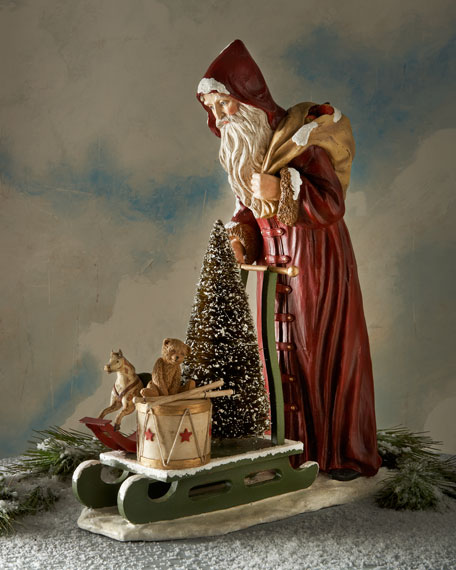 Santa Pushing a Sled