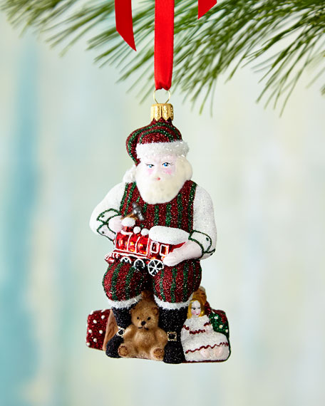 Santa Works His Magic Christmas Ornament